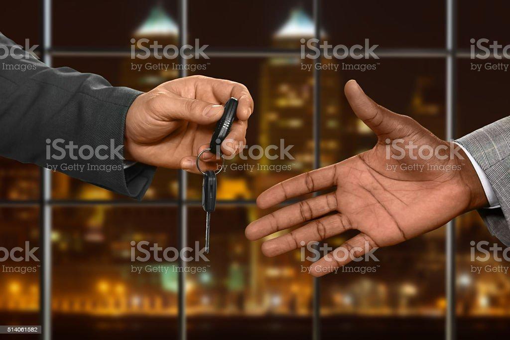 Office employee receives car key. stock photo