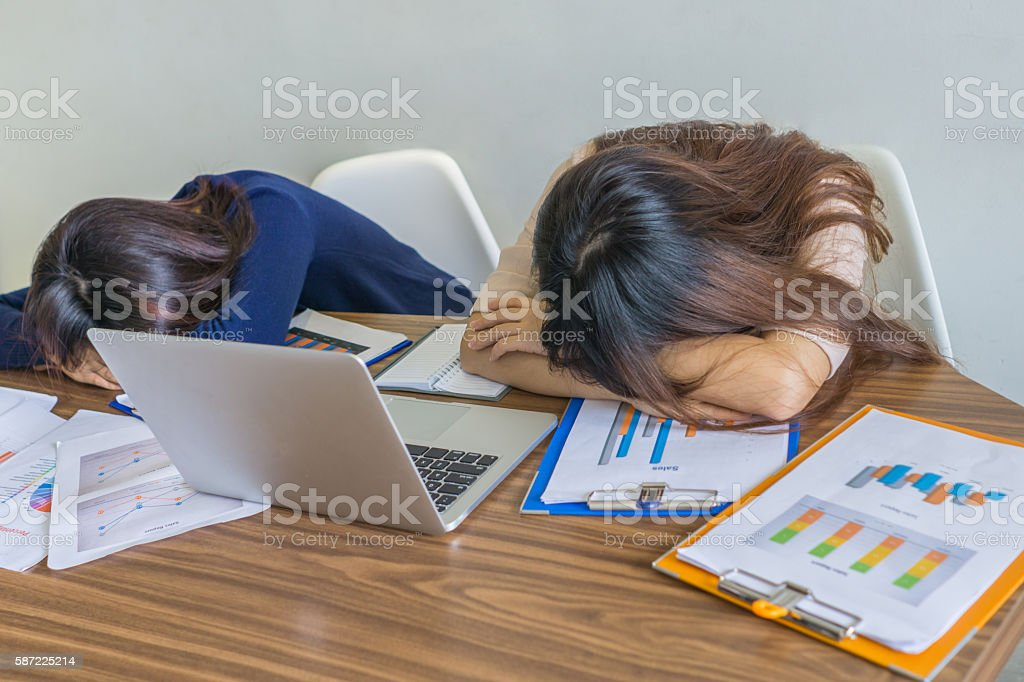 Office employees taking short break after lunch at work place stock photo