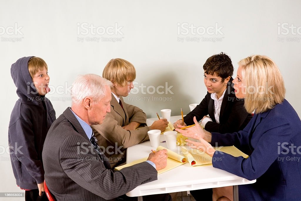 Office employees trying to have conference with child at work. royalty-free stock photo