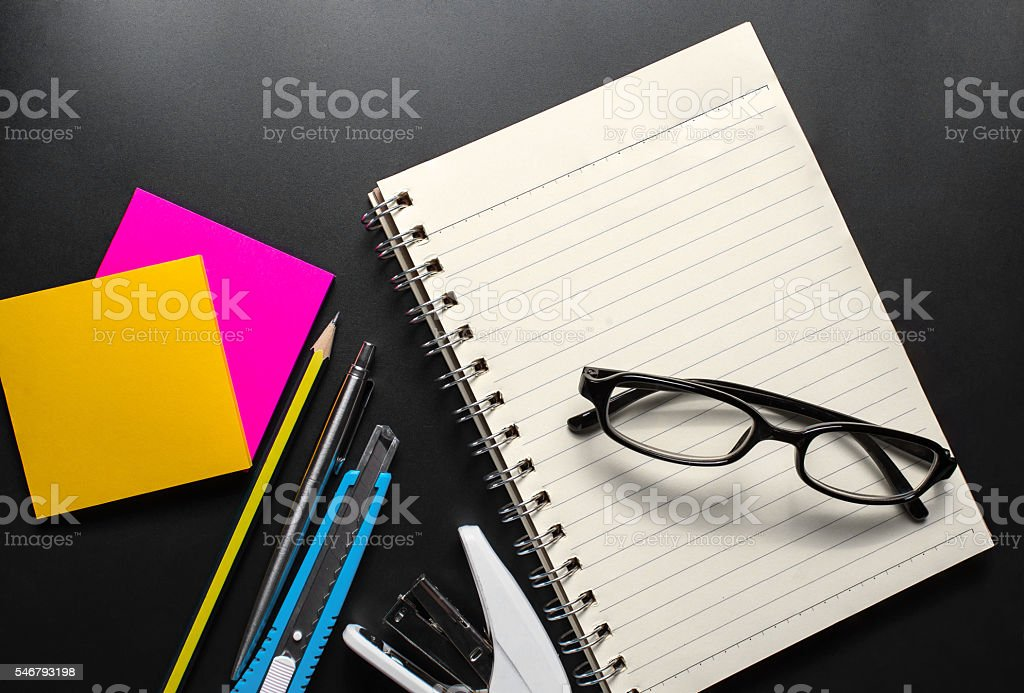 Office equipment on dark background. Top view stock photo