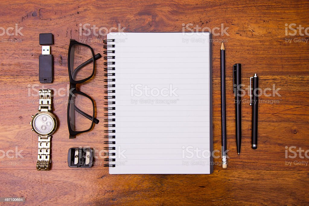 Office essentials on wood stock photo