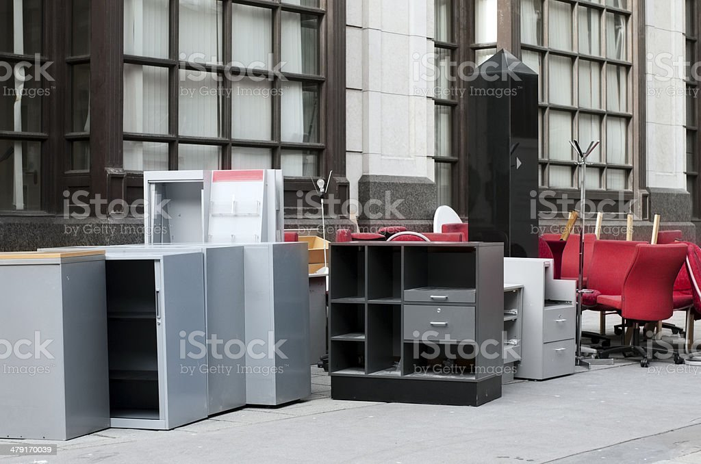 Office furniture stacked on a pavement stock photo
