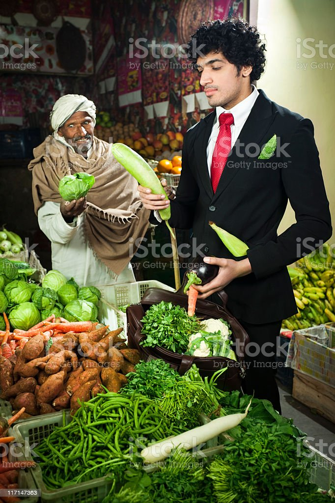 Office geek at greengrocer's shop stock photo