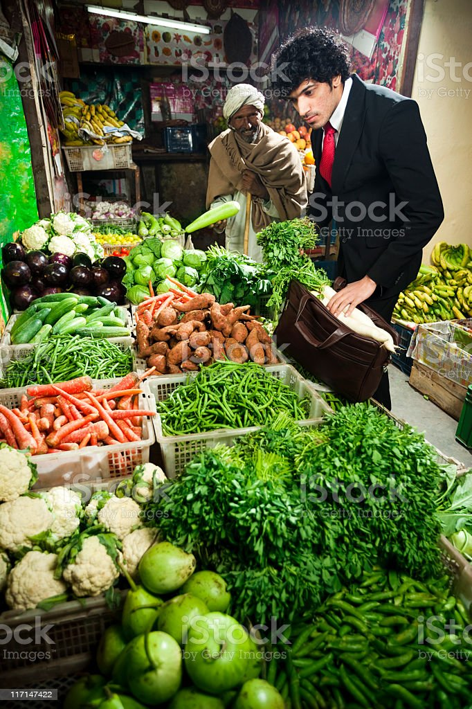 Office geek at greengrocer's shop royalty-free stock photo