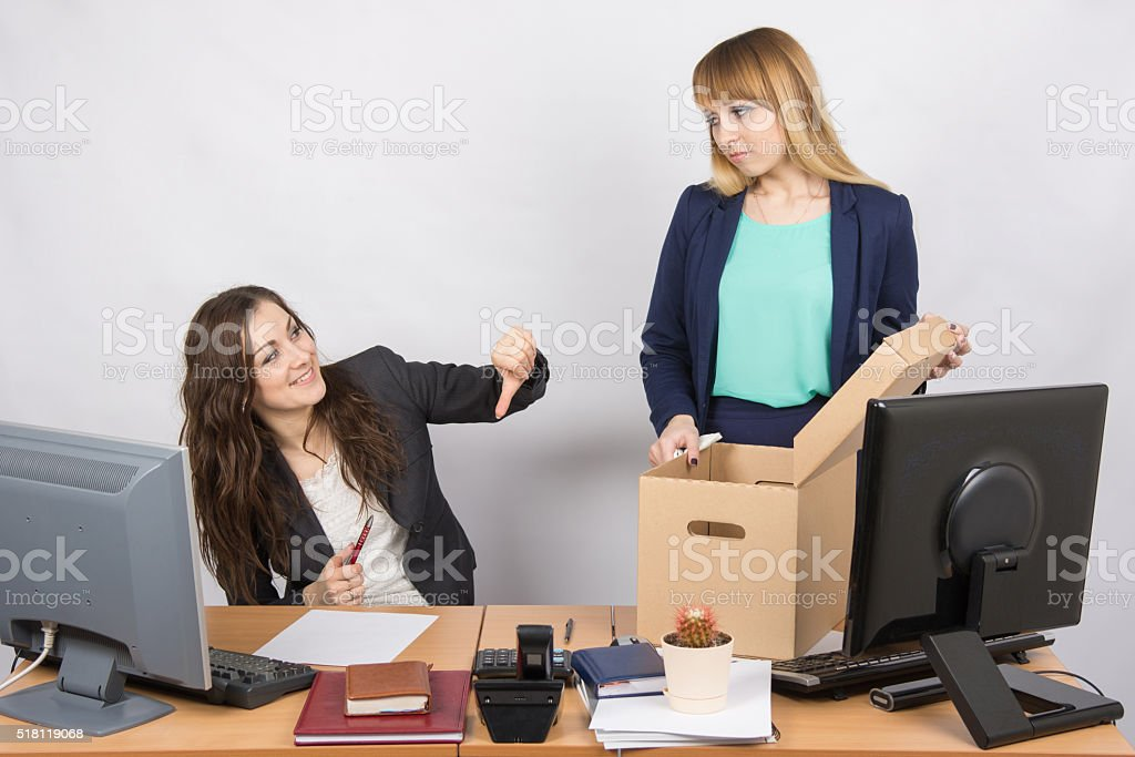 Office gesture girl humiliates the dismissed colleague stock photo