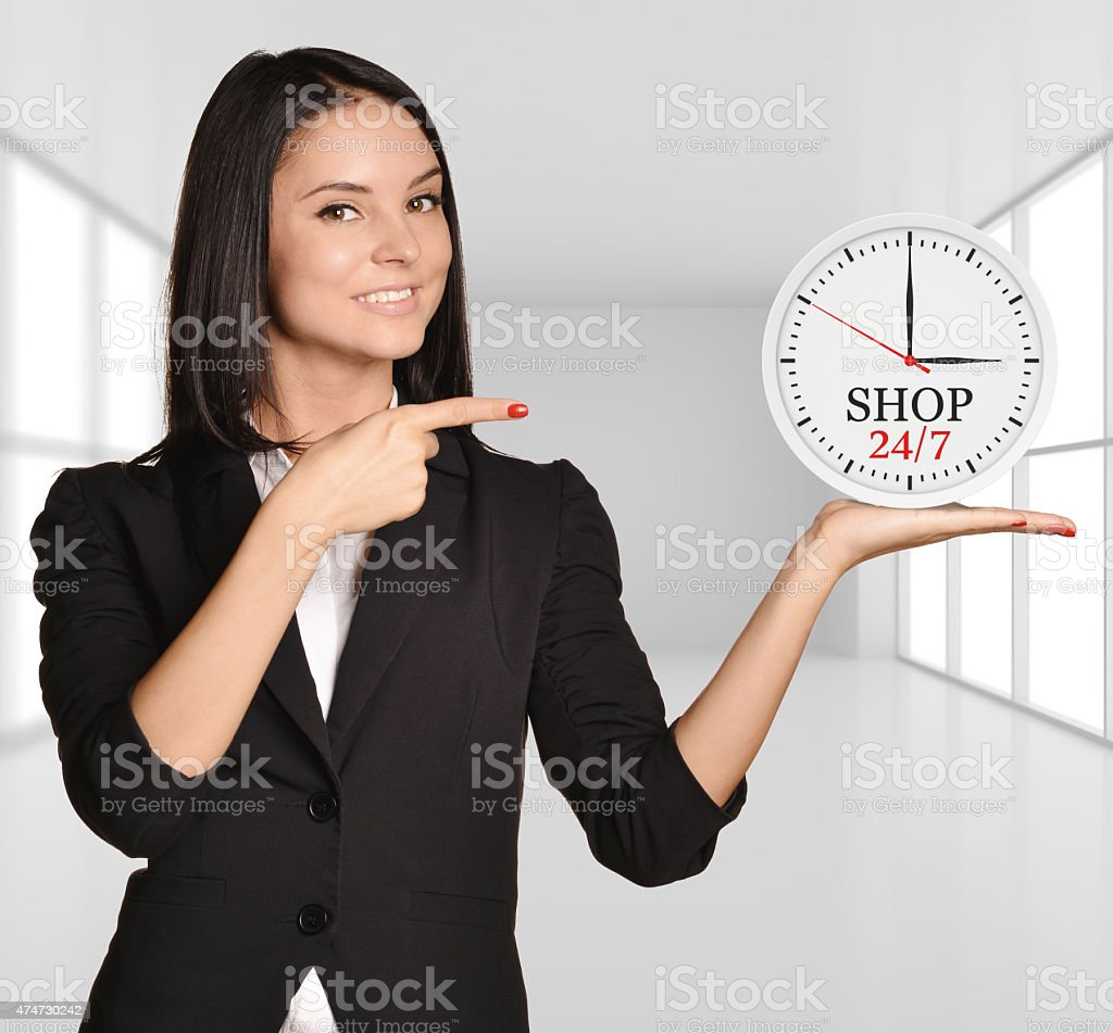 Office girl standing on background of light interior and holding stock photo