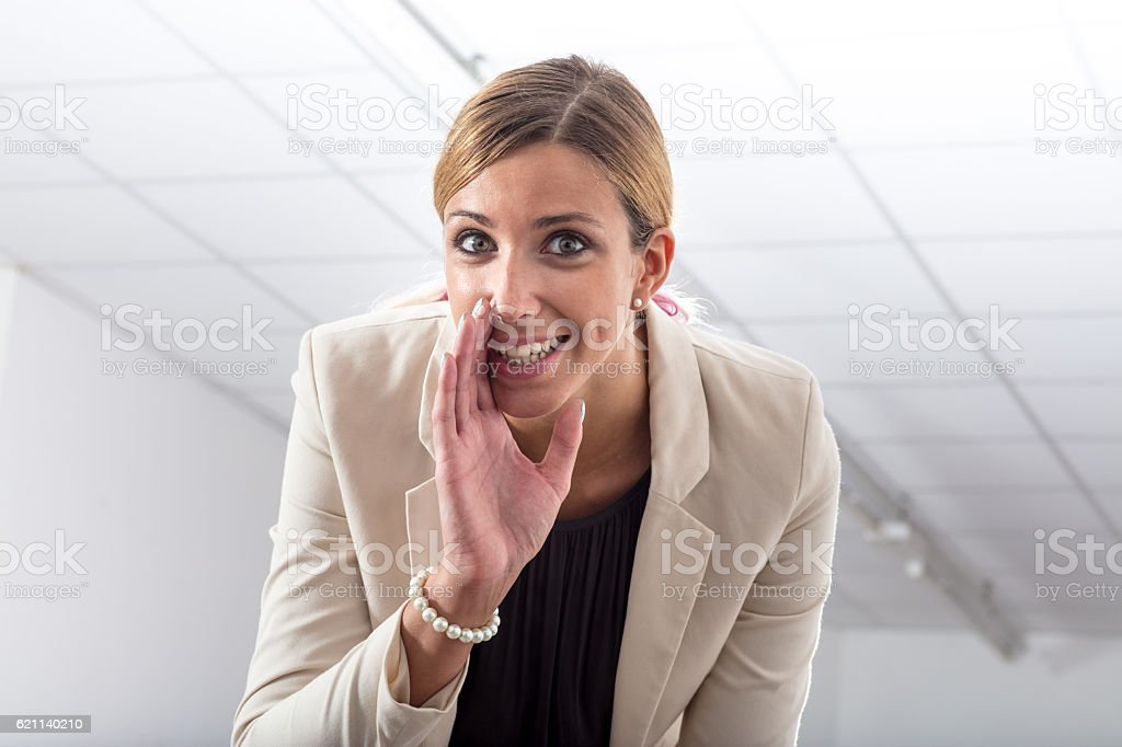 Office gossip whispering a secret stock photo