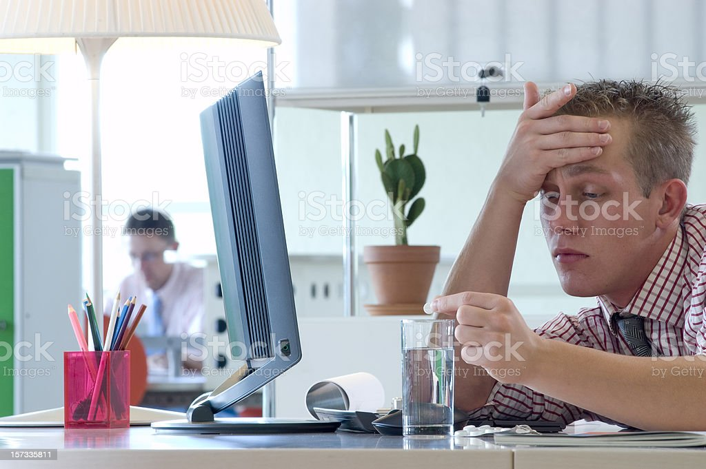 office headache stock photo
