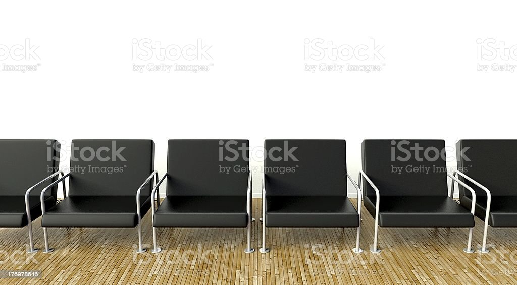 Office interior with armchairs in waiting room on white wall royalty-free stock photo
