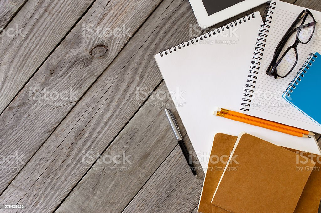 Office Items On The Wooden Desk With Copy Space stock photo