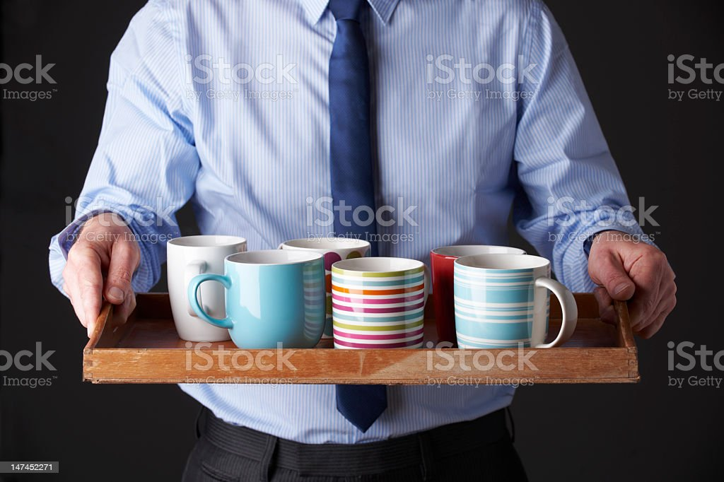 Office Junior Carrying Tray Of Cups stock photo