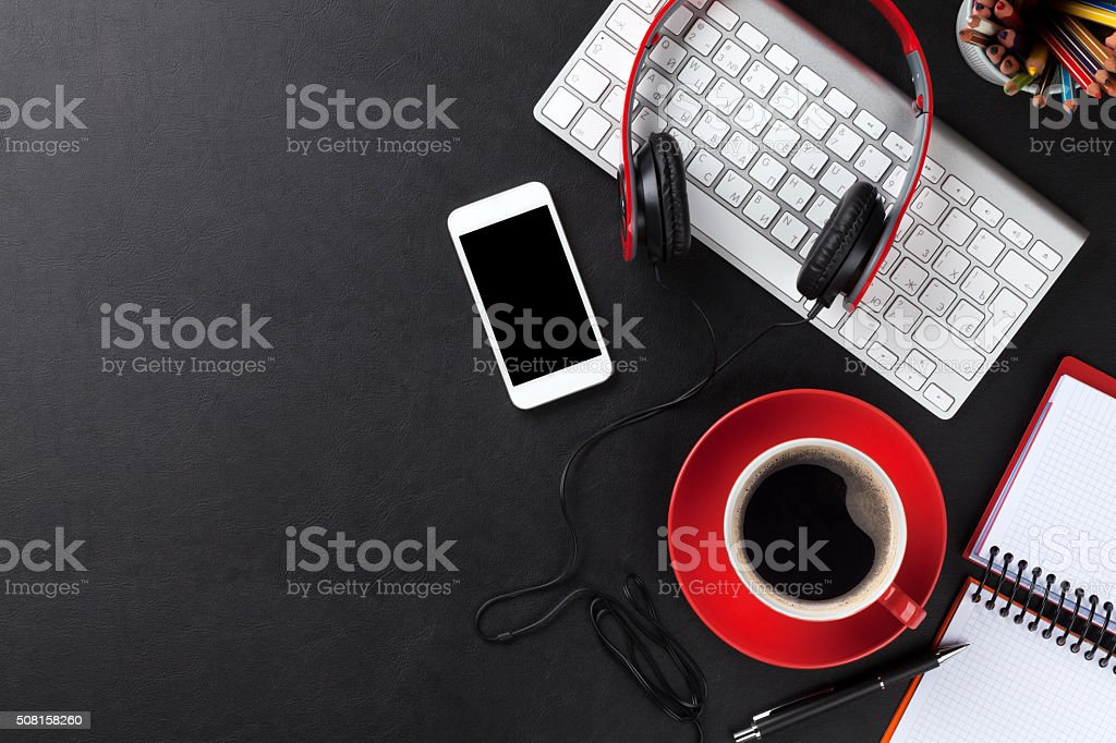 Office leather desk with pc, smartphone and coffee cup stock photo