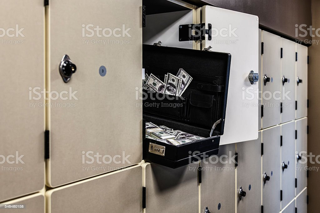 Office Locker Open Briefcase Full of Dark Money stock photo