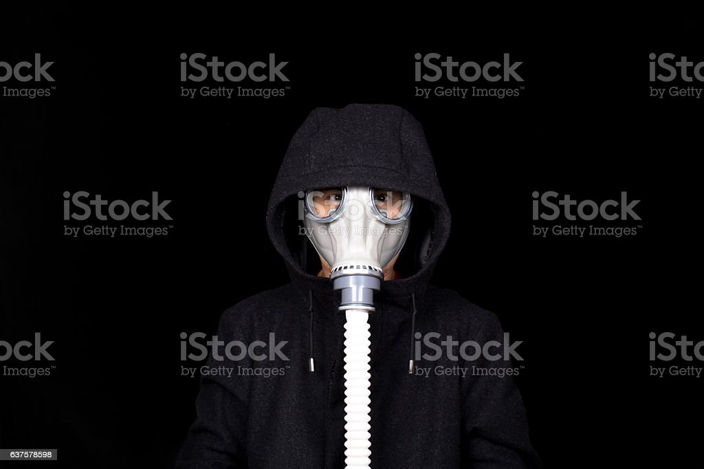 office man wearing gas mask, in tweed coat stock photo