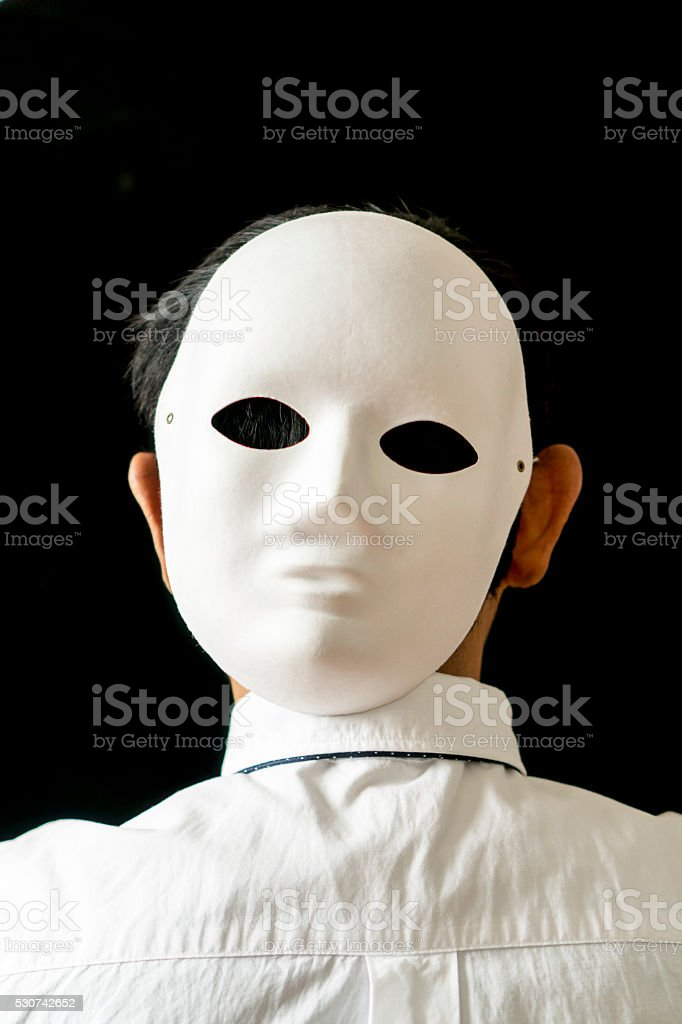office man wearing mask on back of the head stock photo