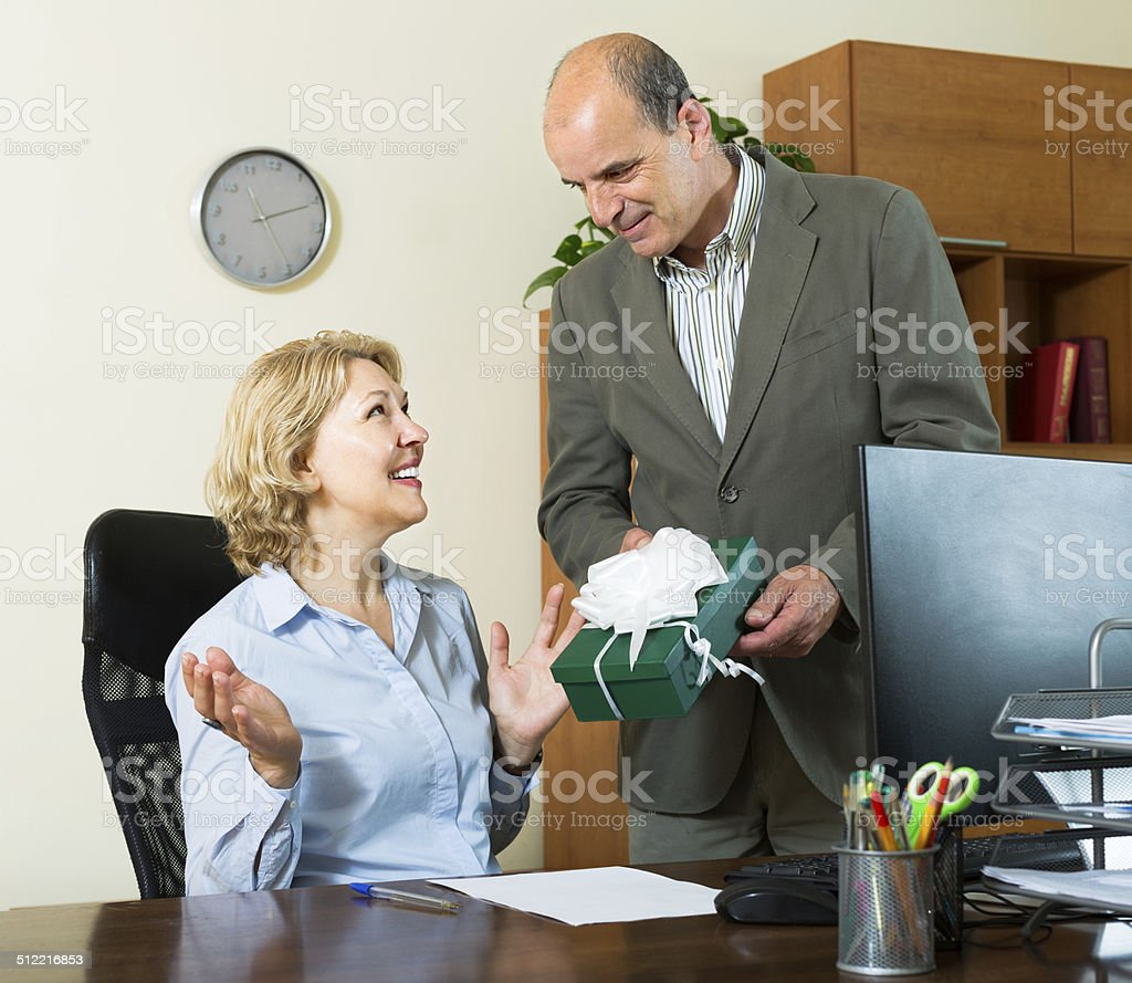 Office manager congratulating secretary stock photo