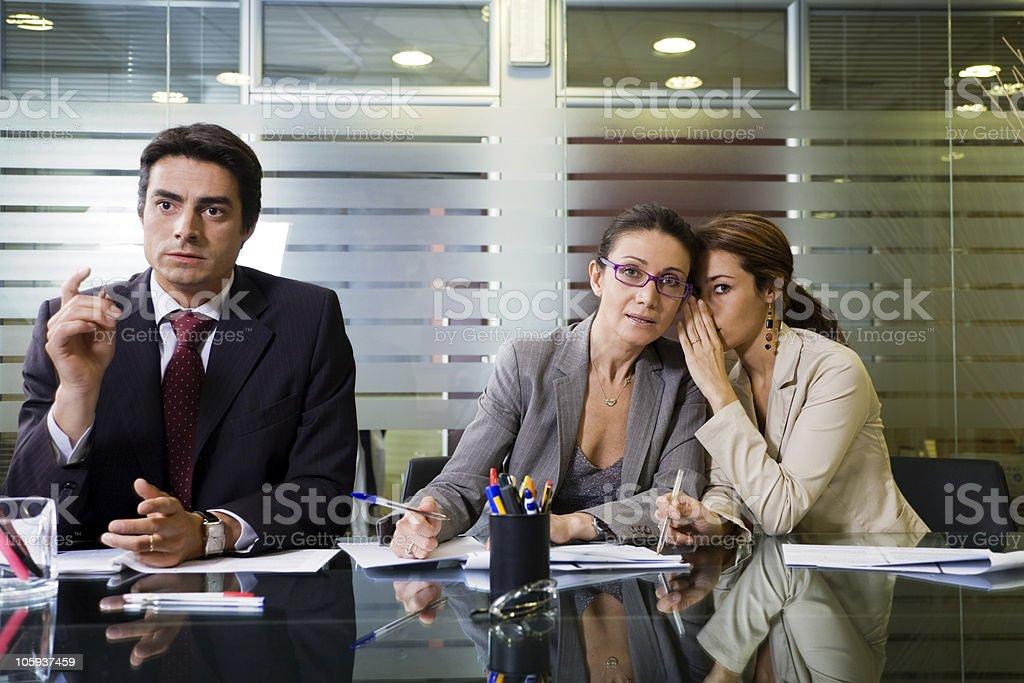 Office meeting with man explaining and women sharing ideas royalty-free stock photo