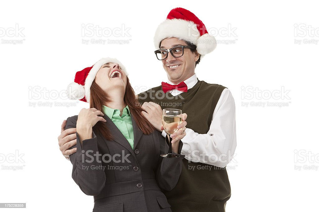 Office Nerd Holding Up Drunk Coworker at Christmas Party royalty-free stock photo