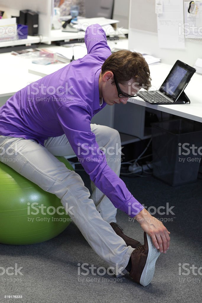 office occupational disease prevention - exercising business man stock photo