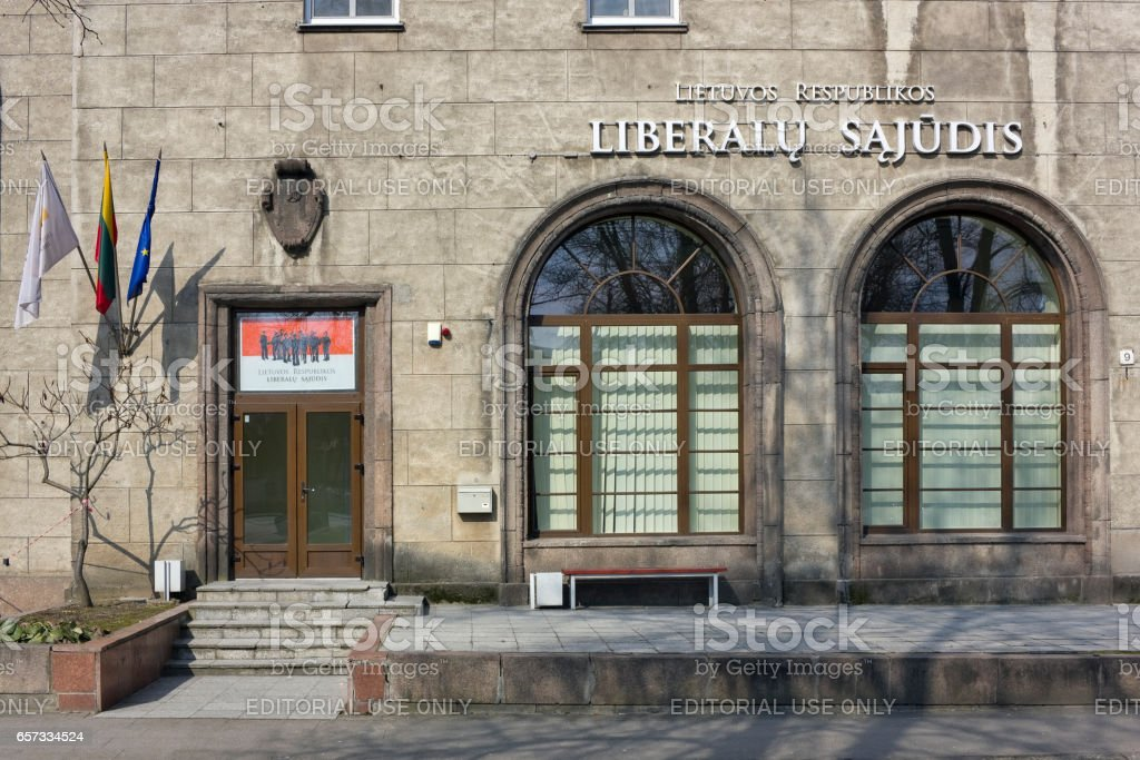 VILNIUS, LITHUANIA - MARCH 27, 2016: Office of the Lithuanian Liberal party (Liberalu Sajudis) it is located in the old house of Stalin times.  Party members  have a rest. Solar quiet Easter morning stock photo