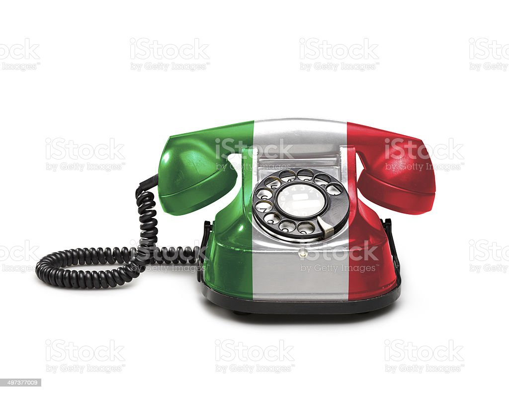 Office: old and vintage telephone with the Italy flag stock photo