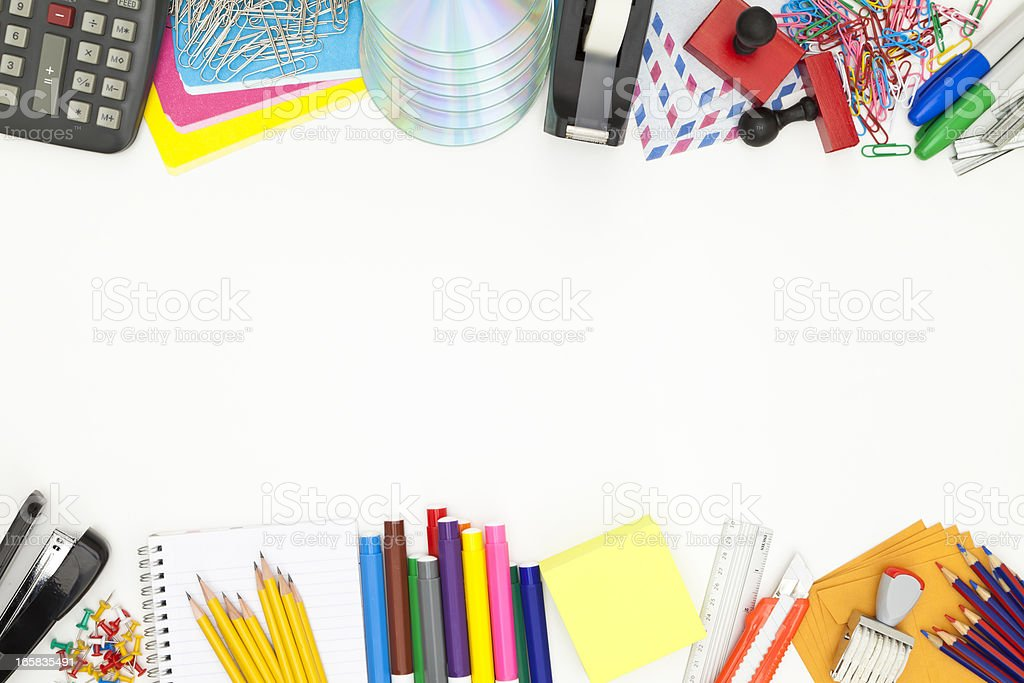 Office or school supplies border shot directly above stock photo