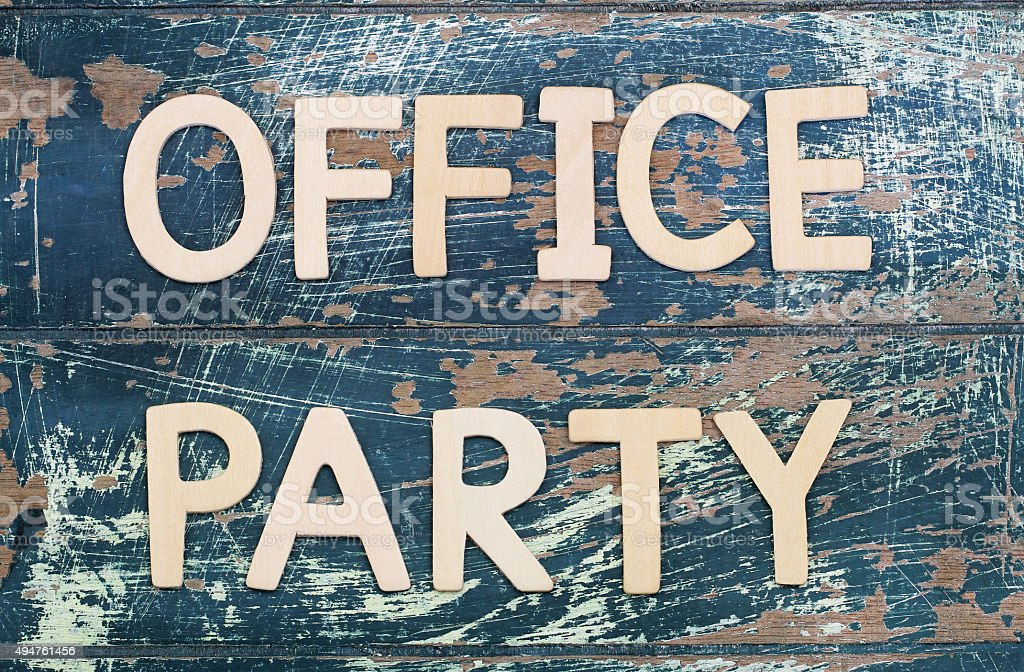 Office party written with wooden letters on rustic surface stock photo