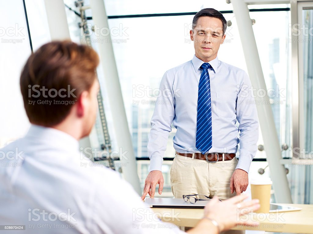 office people discussing business stock photo