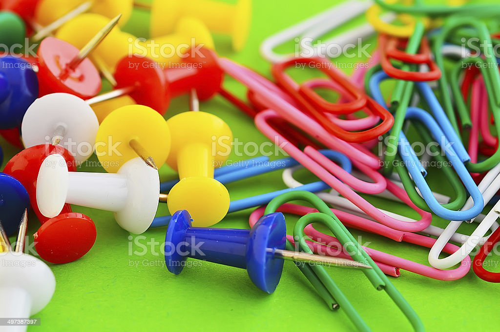 office pinned pins and collection of colorful paper clips stock photo