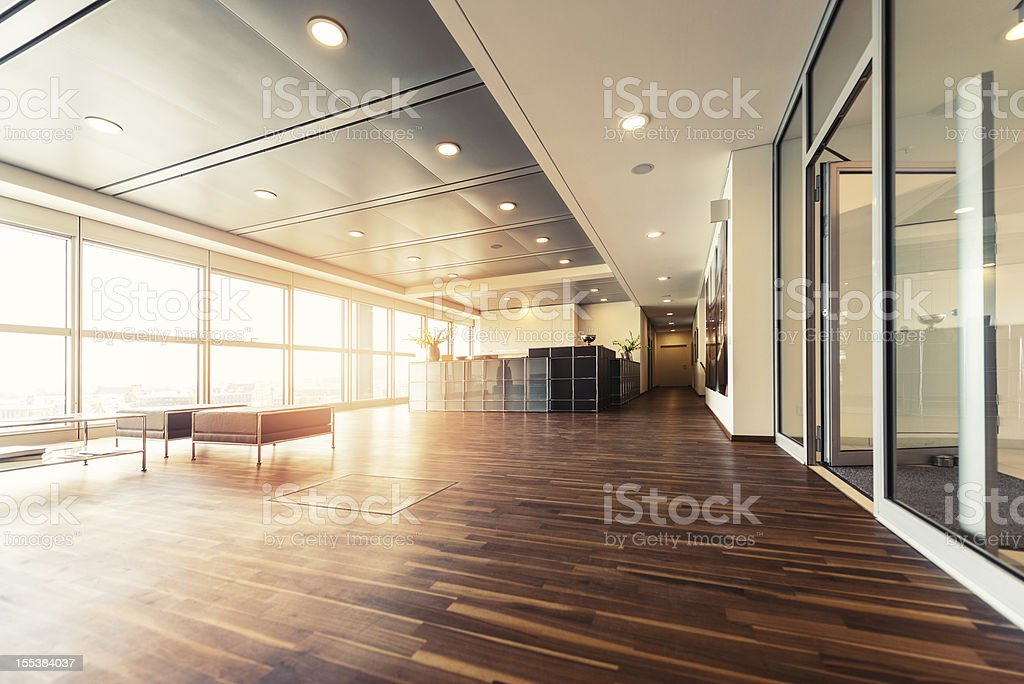 Office reception with wood floors and window wall stock photo