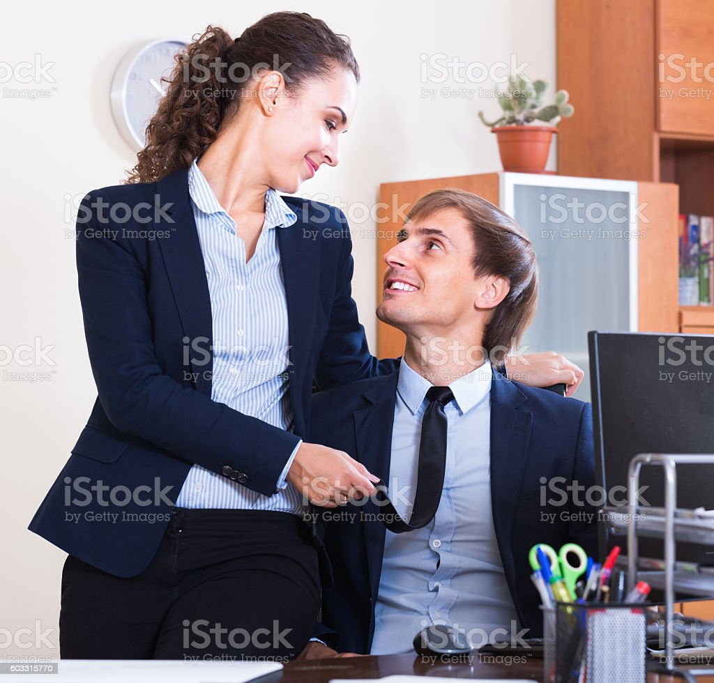 Office romance between clerks at work stock photo