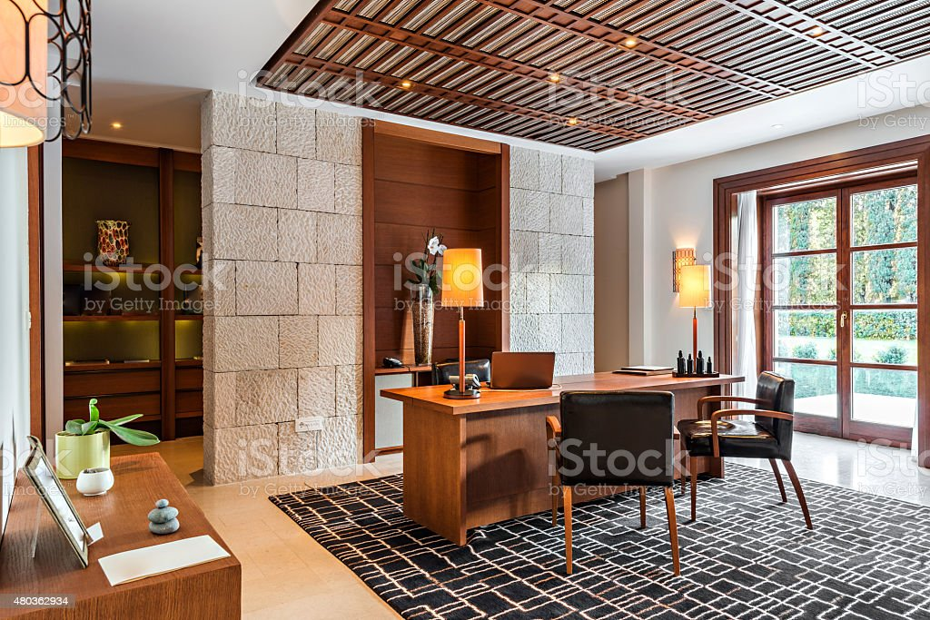 Office room interior with desk and armchair stock photo