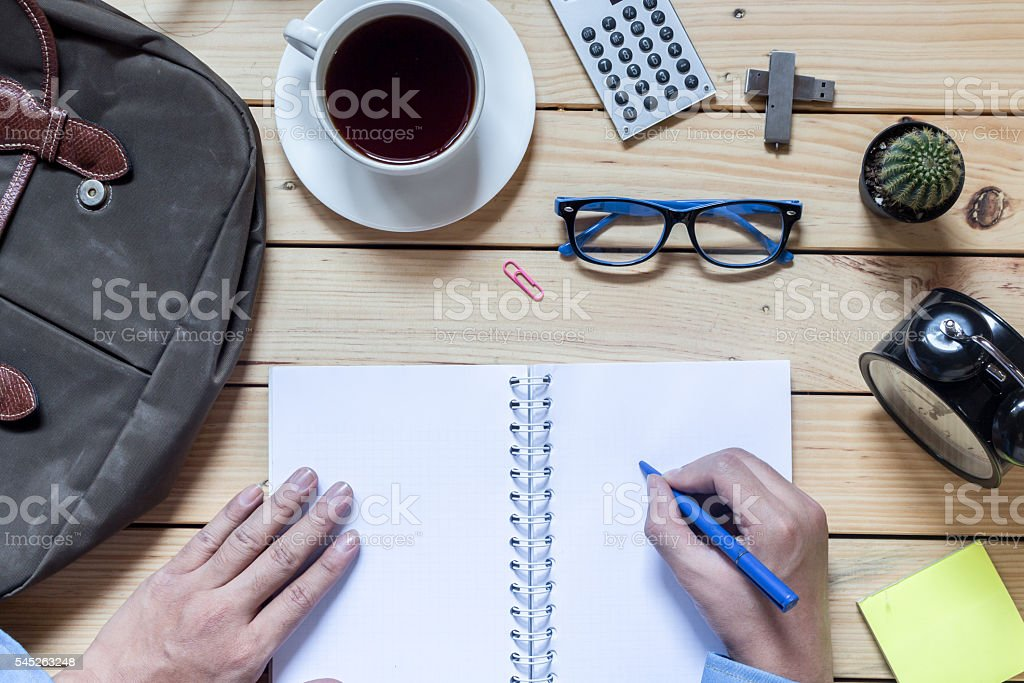 Office supplies and coffee cup on  wooden table stock photo