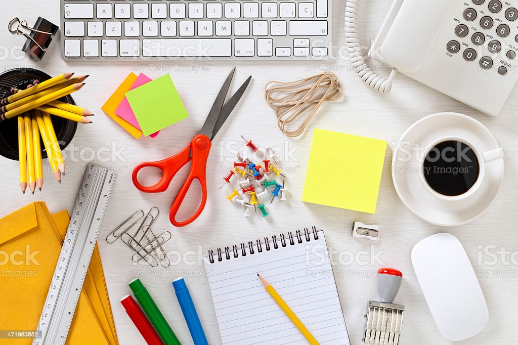 Office supplies and gadgets on gray desktop shot directly above stock photo