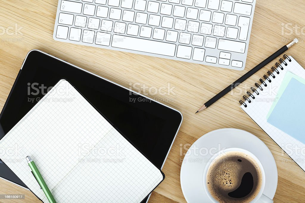 Office supplies, gadgets and coffee cup stock photo