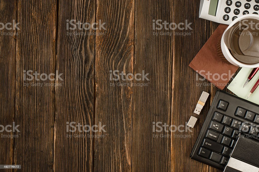 office supplies, gadgets on  wooden table background, top view stock photo
