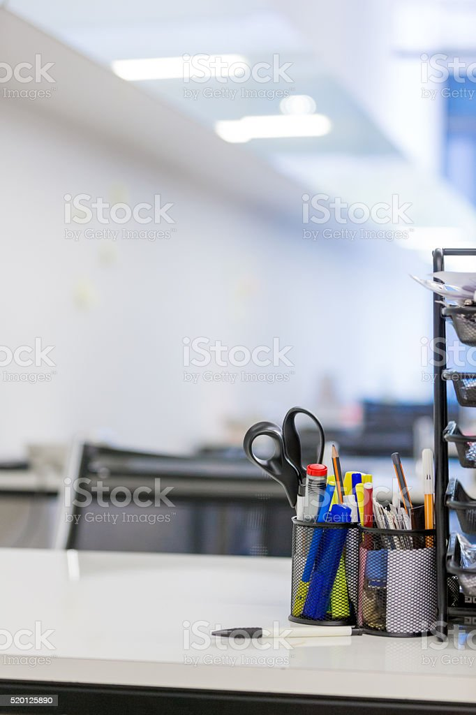 Office supplies in empty office stock photo