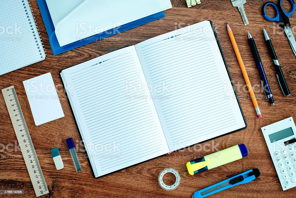 Office Supplies Neatly Organized Around Notebook stock photo