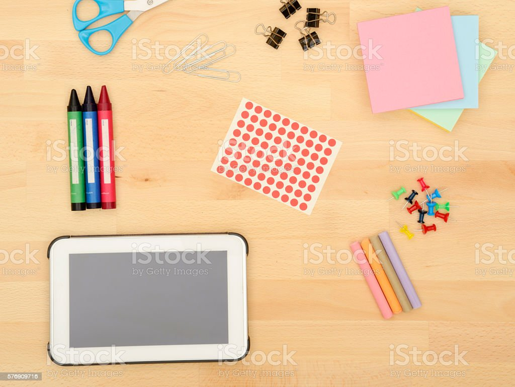 Office Supplies on a wooden desk stock photo