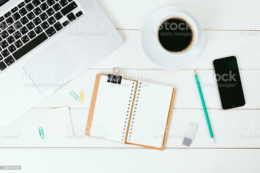 Office supplies on the white wooden table stock photo
