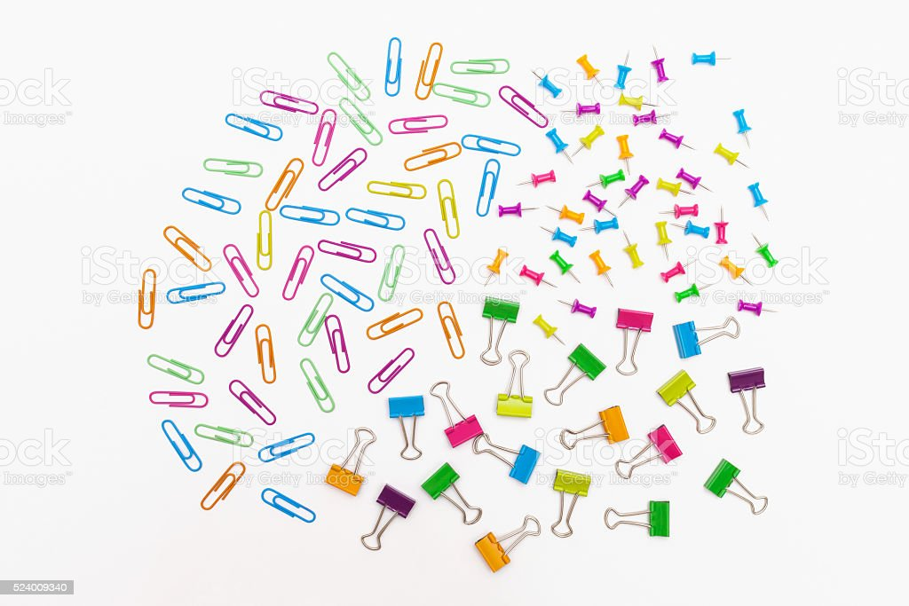 Office Supplies paper clips, binder clips and thumb tacks stock photo