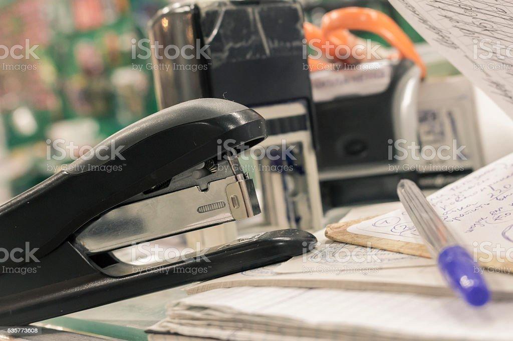Office supplies, stapler and ballpen stock photo