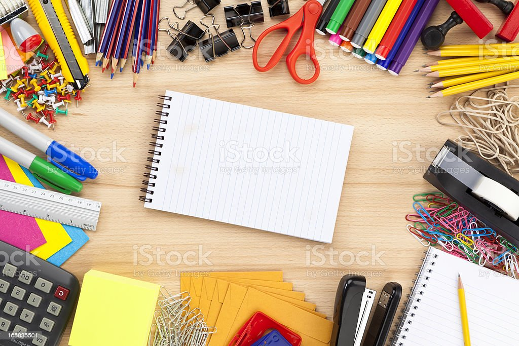 Office supply border with notepad shot directly above stock photo