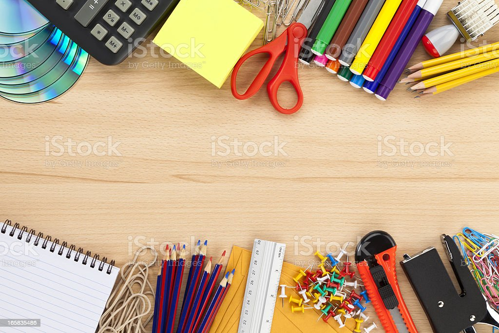 Office supply frame on wood desk top shot directly above stock photo