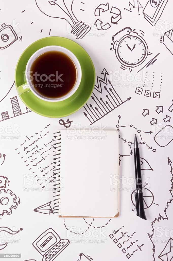 Office table desk with supplies, blank note pad, cup, pen stock photo