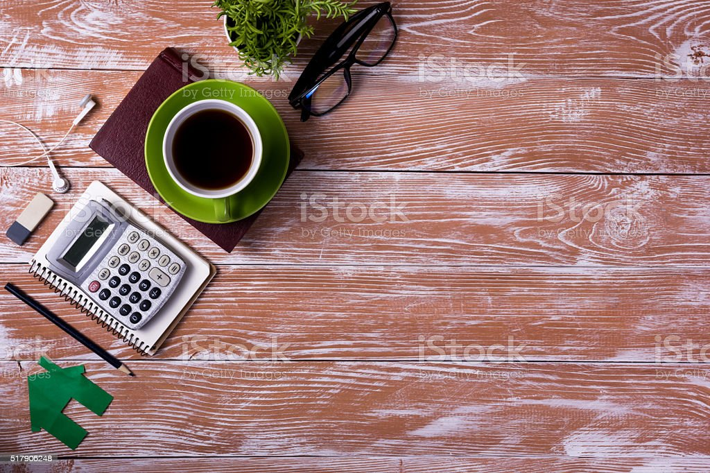 Office table desk with supplies, white blank note pad, cup stock photo