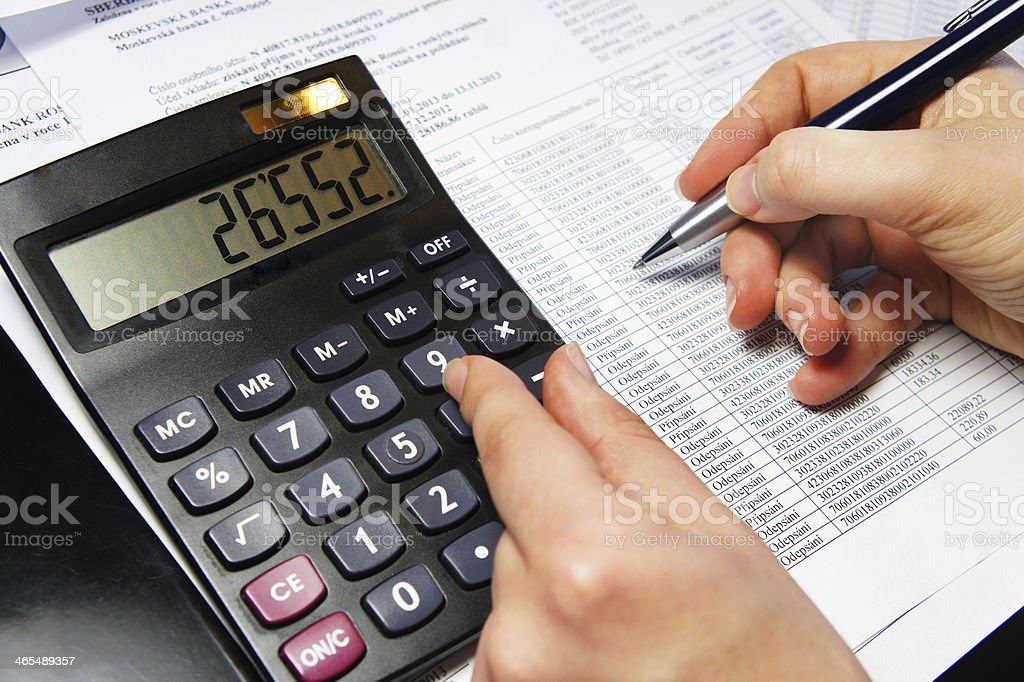 Office table with calculator, pen and accounting document royalty-free stock photo