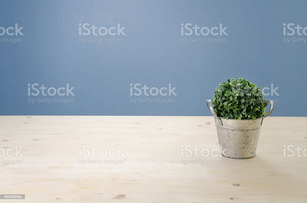 Office table with green  tree on basket stock photo