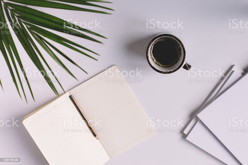 Office table with notepad and coffee cup. stock photo