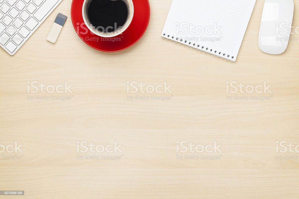 Office table with notepad, computer and coffee cup stock photo